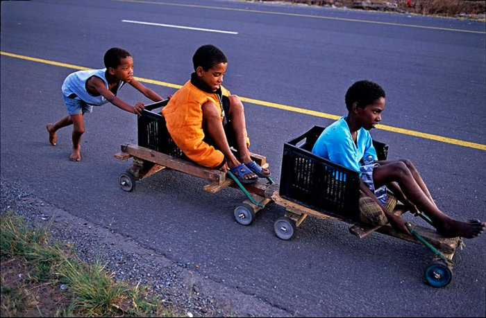 South Africa - Rovos Rail - Black Kids playing with a wooden train